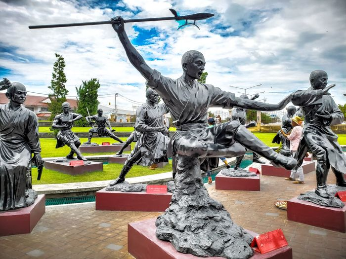 Way of the Warriors. Kungfu  Wushu Chinese Priest Fight Fighting Fighter Jump Backgrounds Statue Thailand Sculpture Statue City Tree Representing Sky Cloud - Sky Male Likeness Buddha