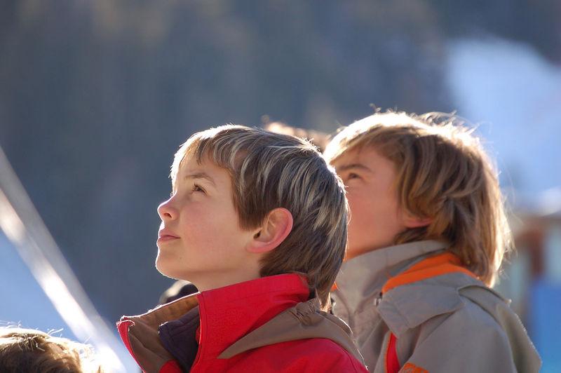 Friends looking away outdoors