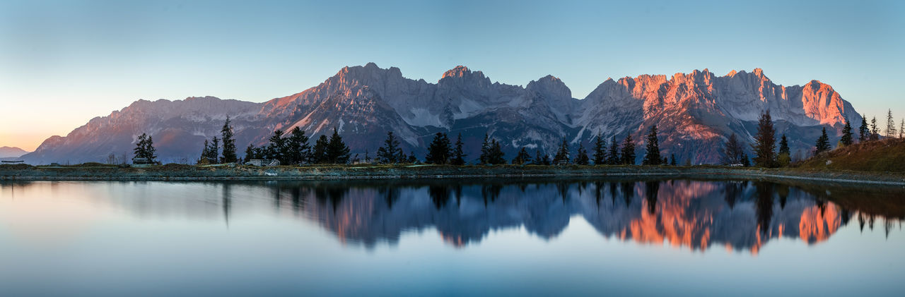 Wilder kaiser sunset, wonderful reflexion in mountain lake