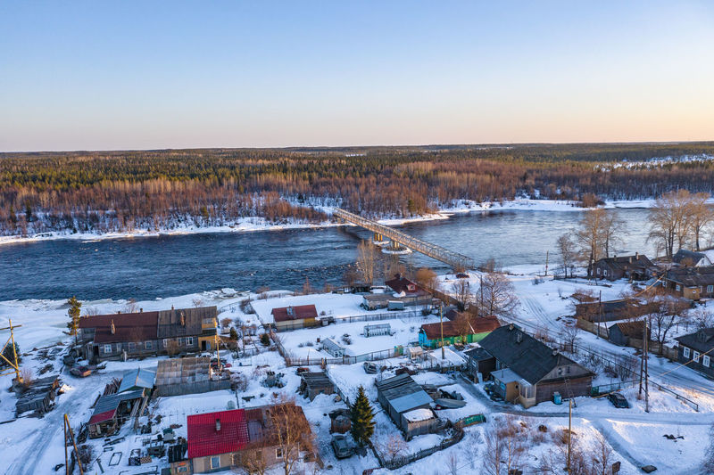 High angle view of frozen lake against sky during winter