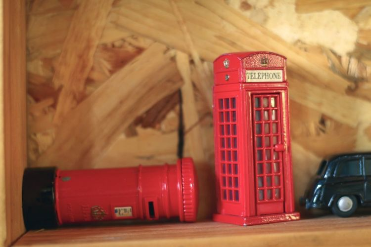Close-up of telephone booth on table