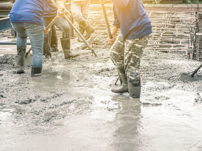 Construction Industry Liquid Ready Textured  Work Workers Backgrounds Cement Concrete Contractor Equipment Floor Metal Mixed Mixing Pattern Plasterer Pour Project Reinforcement Screed Site Structure Wet