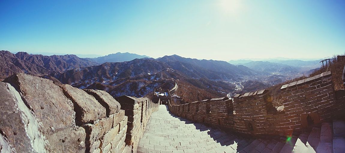 The Great Wall The Great Wall Of China Mountains Mountain Range View Landscape Panorama Nature Outdoors No People China Asian  Travel Traveling Heritage Culture History Architecture Monument Blue Sky Sunlight Perspective Chinese Beijing