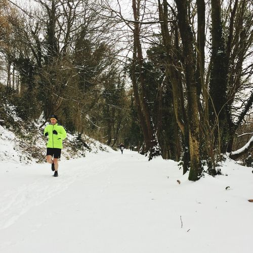 Snow does not stop a run! Snow In Spring! Nailsworth To Stroud Cycle Path Cycle Path Running In Snow Running Winter Cold Temperature Snow Rear View One Person Tree Outdoors