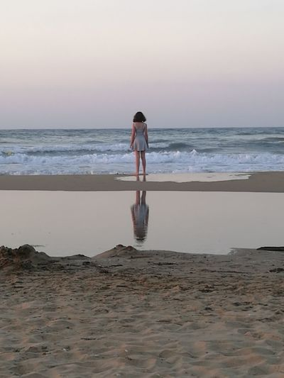 Reflection Contemplating Life Beach Full Length One Person Sea Sand Landscape Sunset Contemplating Greekislands Beachscape Breathing Space Lost In The Landscape Colour Your Horizn