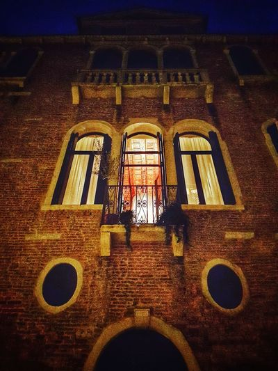 Venice nights Balcony Facades Facade Building Building Exterior Old Buildings Brick Building Residential Building Urban Exploration Venice Venice, Italy Venezia Italy Italia Mistery From Below Night Night Lights Nightphotography Nocturnal Window Arch Architecture Built Structure Residential Structure Historic Building
