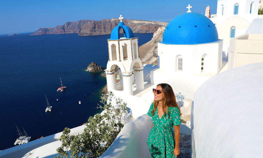 Oia Santorini Oia Village Santorini Island Santorini, Greece Architecture Belief Building Building Exterior Built Structure Day Greece Hairstyle Lifestyles Mountain Nature Oia One Person Outdoors Place Of Worship Real People Religion Santorini Spirituality Young Adult Young Women