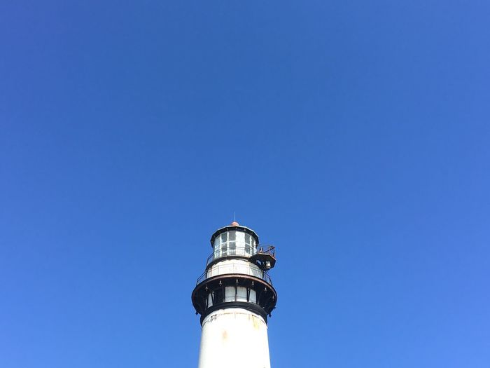 EyeEm Selects Blue Copy Space Clear Sky Day Low Angle View Guidance Architecture Direction No People Built Structure Building Exterior Lighthouse Outdoors Sky