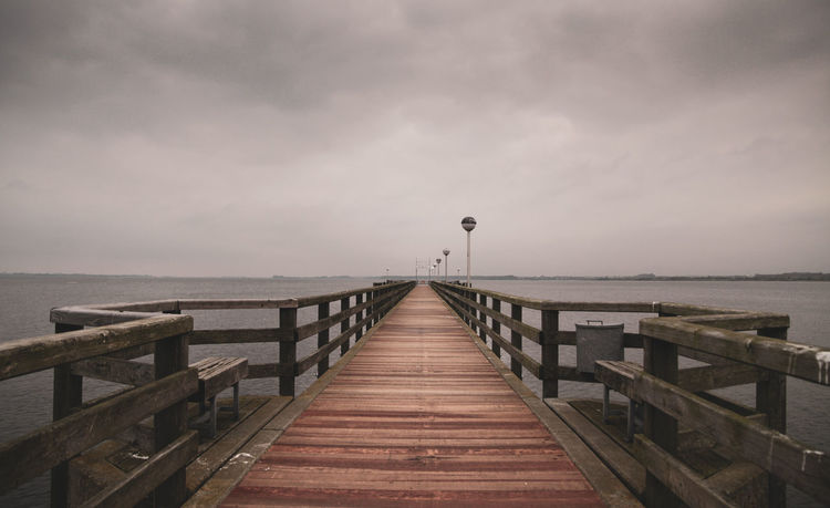 A moody day at the northsea-shore in Germany EyeEmNewHere Moody Sky Rainy Days RainyDay Horizon Moody Atmosphere Moody Nature Moody Weather Outdoors Pier Rainy Sea Sky Tranquil Scene Tranquility Water Wood - Material Wood Paneling