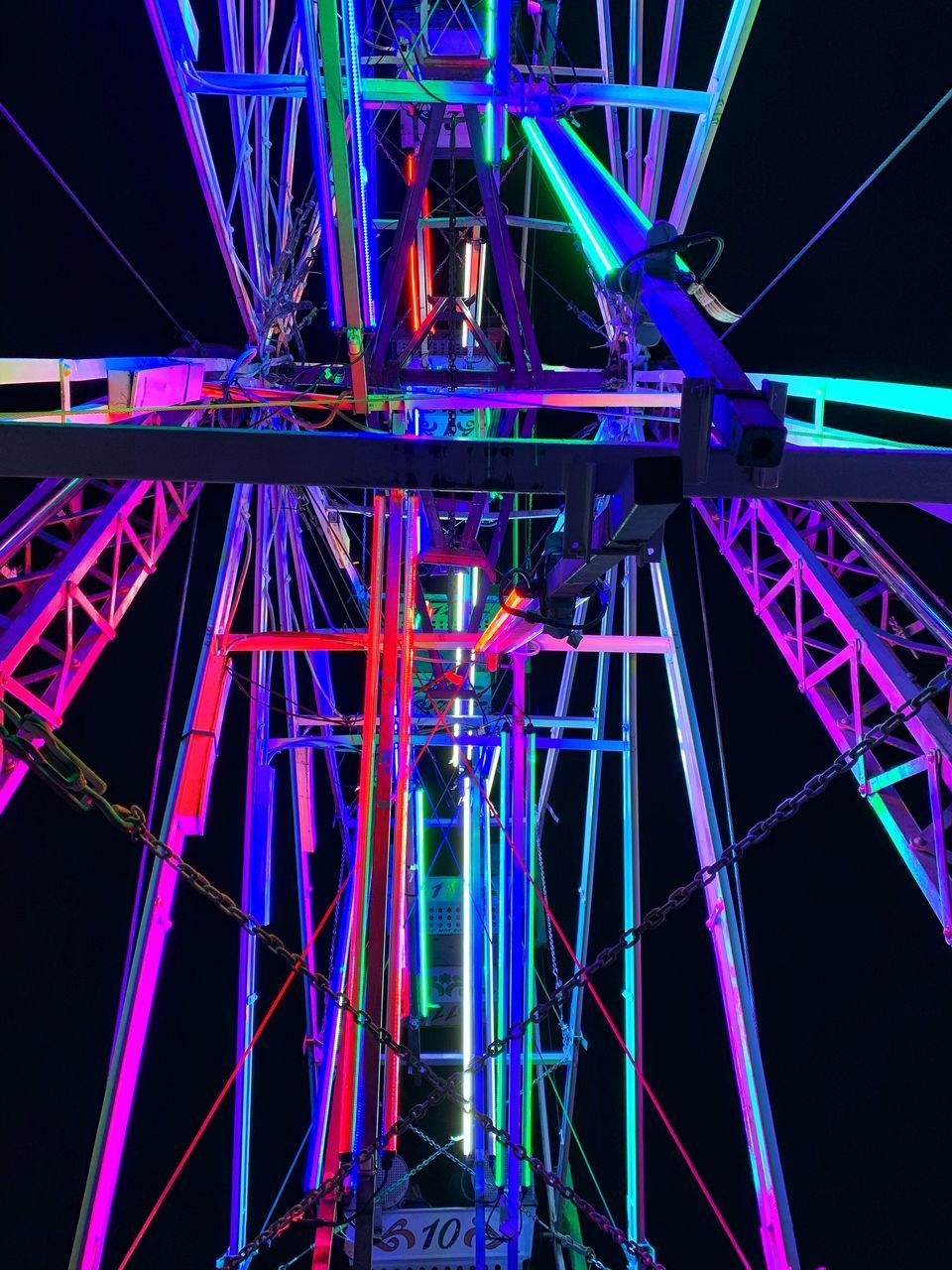 illuminated, night, built structure, architecture, metal, connection, glowing, arts culture and entertainment, no people, blue, bridge, amusement park, lighting equipment, amusement park ride, ferris wheel, low angle view, bridge - man made structure, multi colored, travel destinations, nightlife, laser, purple