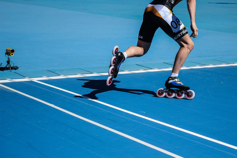 Roller Adult Athlete Blue Competitive Sport Inline Skate Lifestyles Low Section Men Motion One Person Outdoors People Roller Skating Skate Race Skateboard Park Skill  Speed Skating  Sport Sports Sports Clothing Sports Track Sportsman Sunlight Training