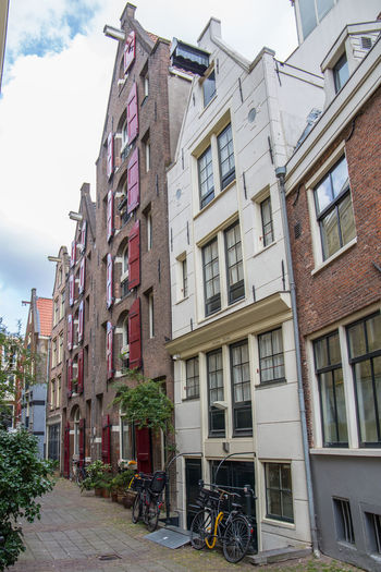 Amsterdam Netherlands Apartment Architecture Building Building Exterior Built Structure City Day Dutch Houses Holland House Land Vehicle Low Angle View Mode Of Transportation Nature No People Outdoors Plant Residential District Sky Street Tourism Transportation Window