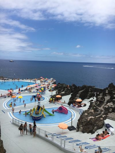 New Lido in Madeira Funchal Madeira Madeira Madeira Island Portugal Childrens Pool Enjoyment High Angle View Horizon Over Water Large Group Of People Leisure Activity Lido Outdoors Real People Relaxation Beside The Sea Sea Sea And Sky Sky Swimming Pool Water