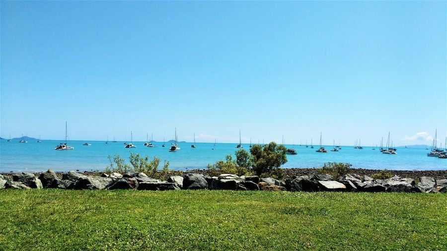 View Bush Clear Sky Day Enjoying Life Grass Horizon Over Water Land Lying Around Nautical Vessel No People Relax Sailboat Scenics - Nature Sea Sky Stone Straight Lines Tranquility Transportation Warm Water