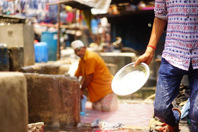 India Mumbai Day Men Occupation Outdoors Real People Two People Washermen Washing Pen Working