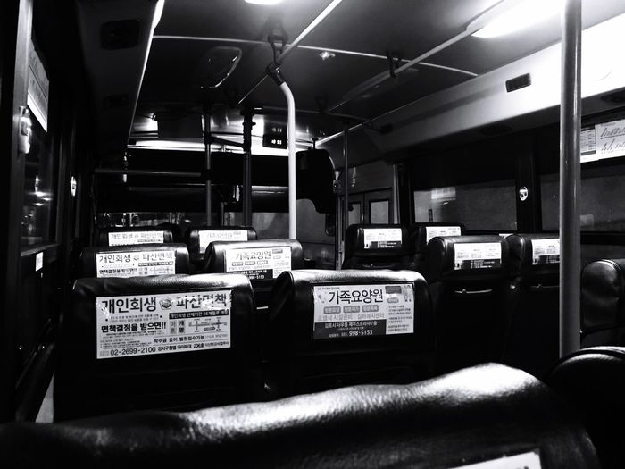 Bus Communication Indoors  Text Western Script No People Technology Mode Of Transportation Sign Arts Culture And Entertainment Public Transportation Business Night Container Seat