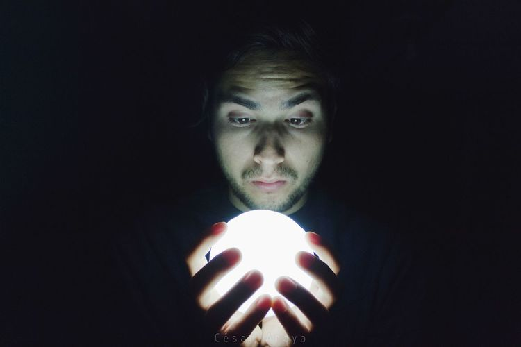 Fortune Telling Crystal Ball Glowing Spooky Mystery Futuristic One Person Illuminated Indoors  Adult Black Background Holding Close-up Human Hand People