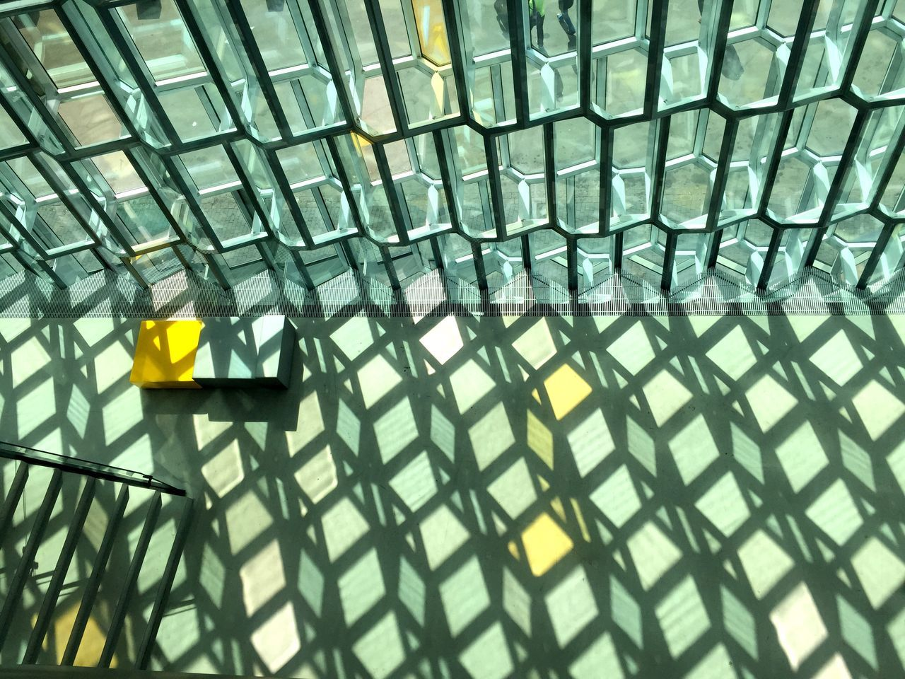 High angle view of shadow of glass window on floor at lobby