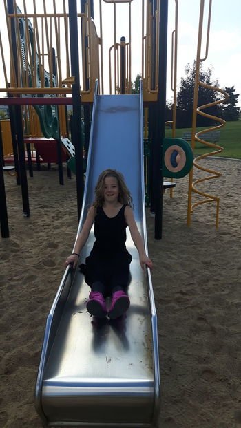 EyeEm Selects childhood Playground Outdoor Play Equipment Child Children Only Fun One Person Jungle Gym One Girl Only Full Length Playing Girls People Day Outdoors Spruce Grove, Alberta