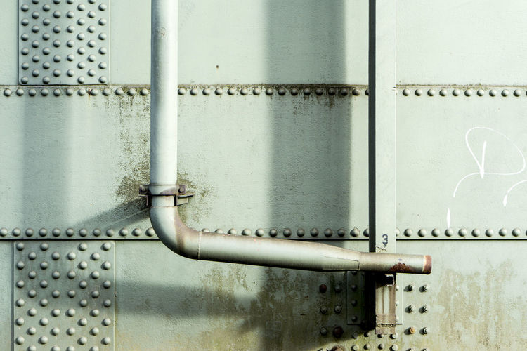 Close-up of pipes on metallic wall