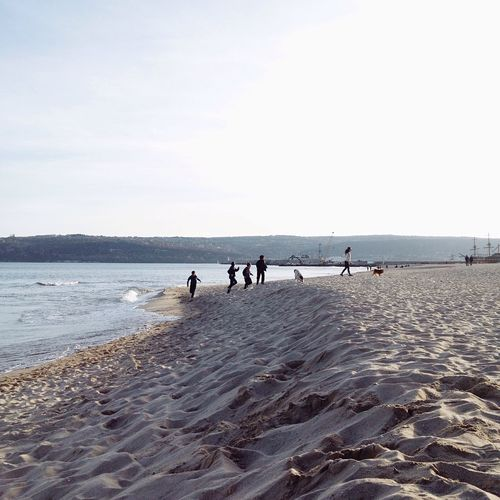 Beach Sea Sky Real People Horizon Over Water Leisure Activity Lifestyles Water Nature Men Outdoors Scenics Beauty In Nature Day Togetherness People Adult Walking A Dog Beach Activity Varna Winter Beach Sand Running On The Beach Kids Having Fun Enjoy The New Normal This Is Family