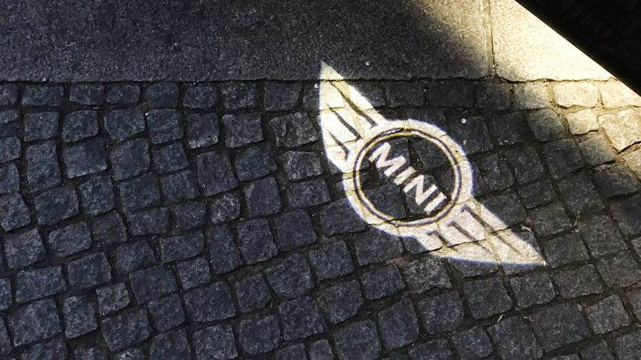 High Angle View Communication Street Day Symbol Outdoors No People Road Sign Road Close-up Mini Mini Cooper Bmw Mini Mini Cooper S Car Cars Carspotting Carsofeyeem Ligjt And Shadow Cobblestone Cobblestone Streets Icon