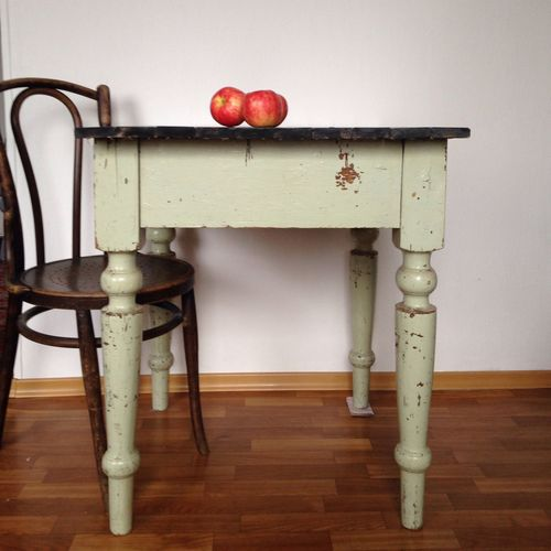 Apples On Table With Chair On Hardwood Floor
