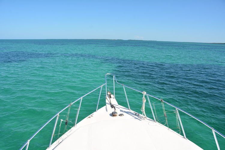 Blue Blue Sky Boat Boat Ride Boat Trip Distant Going On A Boat Ride Green Horizon Horizon Over Water Journey Leading Looking Forward Ocean Ocean View On The Boat Outdoors Rippled Sea Trip Vacation Vacations Water