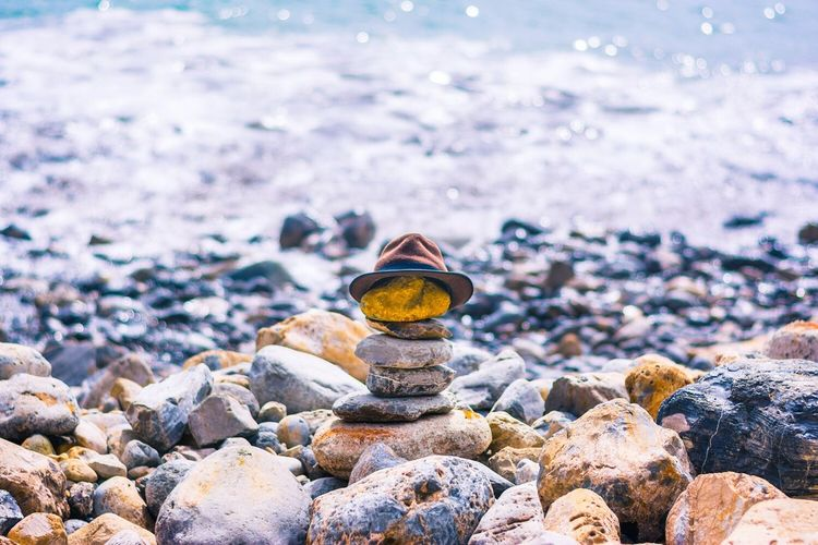 Totem Hat Rock - Object Nature Water Pebble Stone - Object Sea Beach Close-up No People Outdoors Beauty In Nature Day Pebble Beach Totem Rockpile Hat