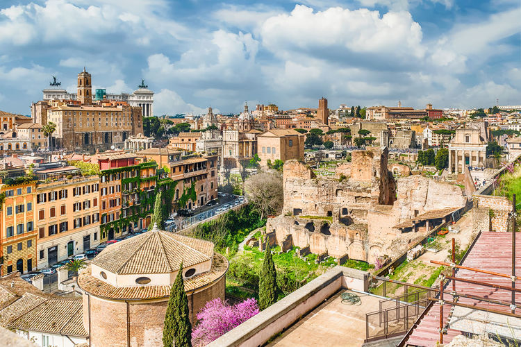 View of roman forum against cloudy sky