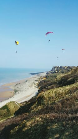Sea Beach Flying Blue Sand Leisure Activity Sport Adventure Paragliding Horizon Over Water Travel Destinations Parachute Sky Kiteboarding Outdoors Beauty In Nature Extreme Sports Nature Water Day Normandy Gold Beach Ddaybeaches Ddaylandings Dday