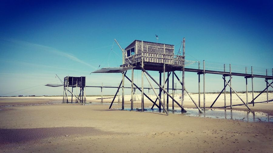 Beach Lifeguard  Sand Lifeguard Hut Sea Sky Water Outdoors Day No People Clear Sky Nature Fisherman Hut The Architect - 2017 EyeEm Awards