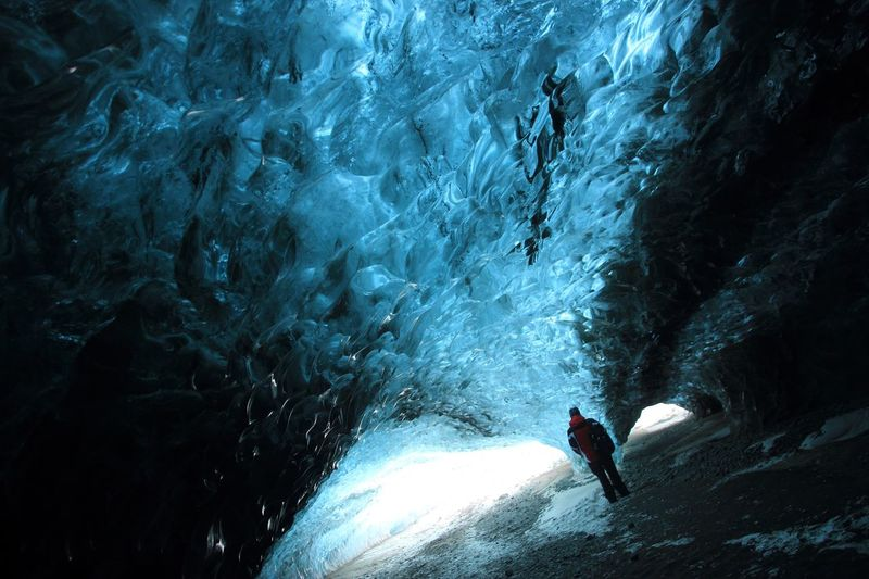 Rear view full length of man standing in ice cave