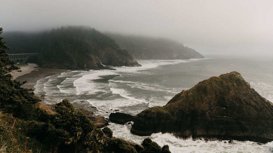 Oregon Oregon Coast Pacific Northwest  Ocean Pacific Ocean Fog In The Trees Fog Foggy Weather Water Scenics - Nature Beauty In Nature Bridge Tranquility No People Tranquil Scene Non-urban Scene Flowing Water Outdoors Power In Nature Rocky Coastline Sea Coastline Coastline Landscape Rock - Object Rock Nature Solid Sky Land