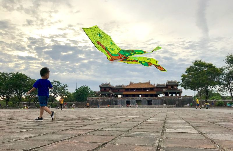 Kid with kite Playing Kids Skies And Clouds Playing Time Fun Skies And Clouds Sky Real People Cloud - Sky Tree Nature Day Lifestyles One Person Mid-air Plant Leisure Activity Flying Men Representation Incidental People Childhood Outdoors This Is Strength A New Perspective On Life