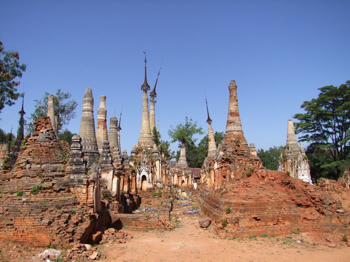 Forest of Ancient Stupa (11th to 13th century) Ancient Ruins Blue Sky Brick Buildings Buddhism Buddhist Architecture Buddhist Stupas Composition Inle Lake Kakku Myanmar No People Old Ruins Outdoor Photography Place Of Prayer Place Of Worship Religion Shan State Stupas Sunlight And Shadow Tourism Tourist Attraction  Tourist Destination Trees