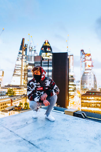 City Colors Exploring Fashion London Streetwear Architecture Bokeh Building Building Exterior Built Structure Camouflage City Cityscape Cold Temperature Front View Full Length One Person Outdoors Real People Sky Skyscraper Streetphotography Style Sunset The Fashion Photographer - 2018 EyeEm Awards