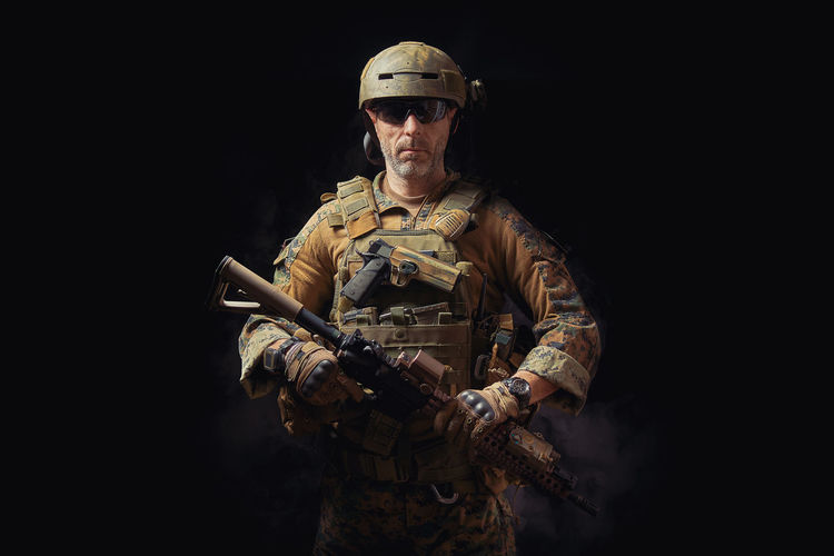 special forces soldier of the united states poses with a rifle on a black background American Elite Gun Soldier Uniform Armed Army Assault Rifles Commando Firearms Forces Infantry Marines Military Navy Operator Ranger Rifle Special Troops Us War Warfare Warior Weapon