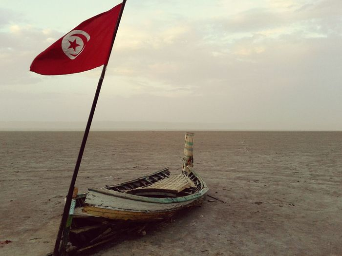 Boat On Sand Old Boats Ruins Tunisia Tunisia Flag Desert Cloudy Evening Red Flag Evening Cloudy Skies Boat Desert Landscape Desert Boat Boat On Land Chott El-Jerid