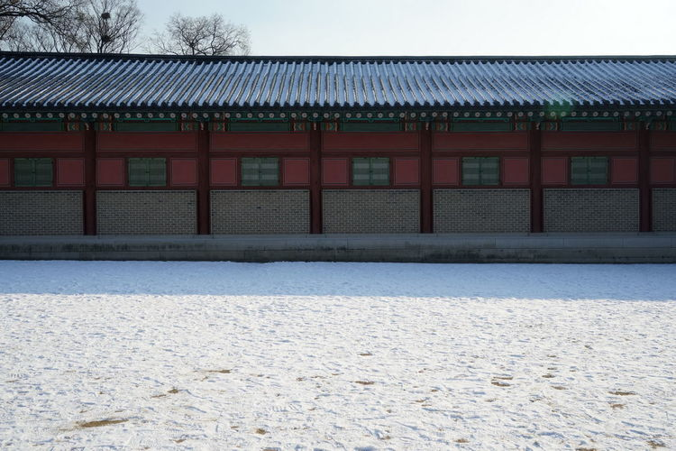 Changduk Palace Korean Traditional Architecture UNESCO World Heritage Site Winter Architecture Building Exterior Built Structure Day Exterior No People Outdoors Roof Seoul City Sky Snow Travel Destinations