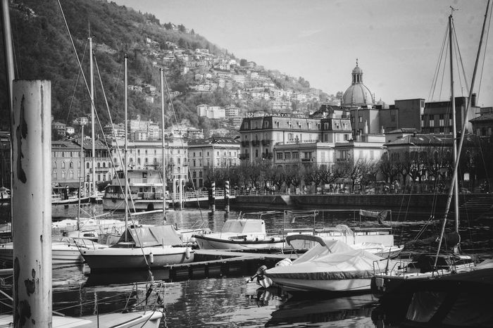 Il porto di Como è bellissimo Kevincaetano Church City Cityscape Lifestyles Light And Shadow Reflection Boat Harbor Water Waterfront Water Reflections Como Lake Italia Tranquility Travel Destinations Black And White Blackandwhite Lake Lake View Landscape Outdoors No People Day Moored Water Nautical Vessel Sky