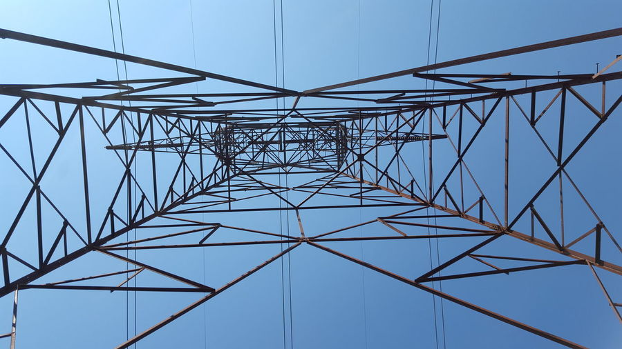 Directly Above Shot Of Electricity Pylon Against Clear Sky