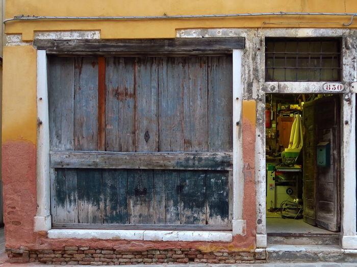 Open door and windows in decay