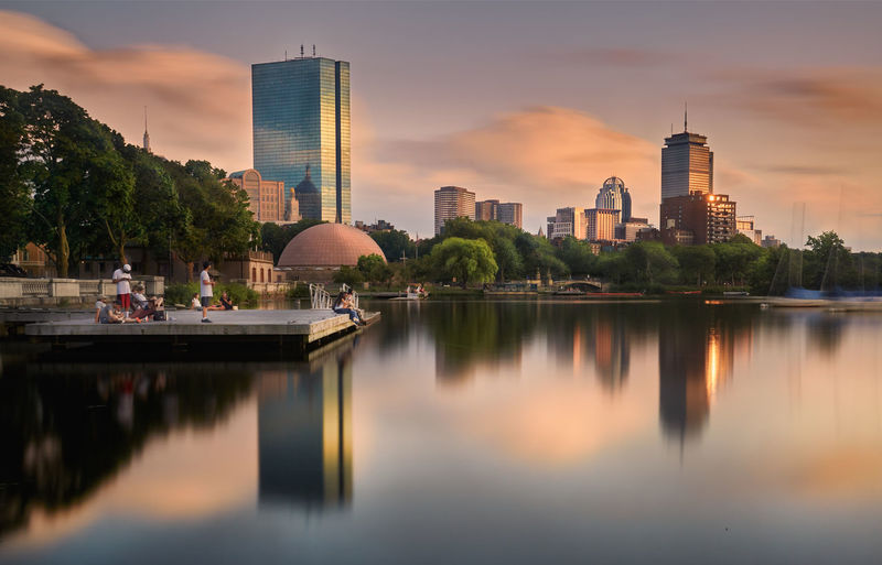 Reflection of buildings in lake at sunset