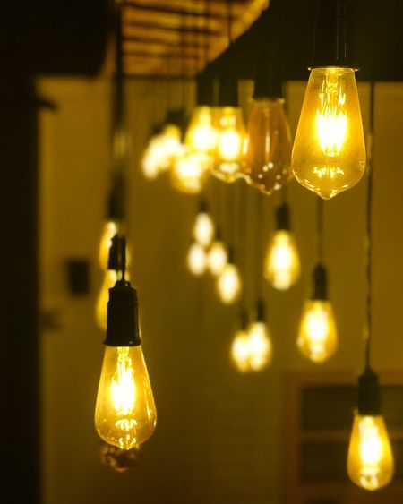 Glowing Dangles.. Lighting Equipment Illuminated Electricity  Indoors  Focus On Foreground Glowing Light