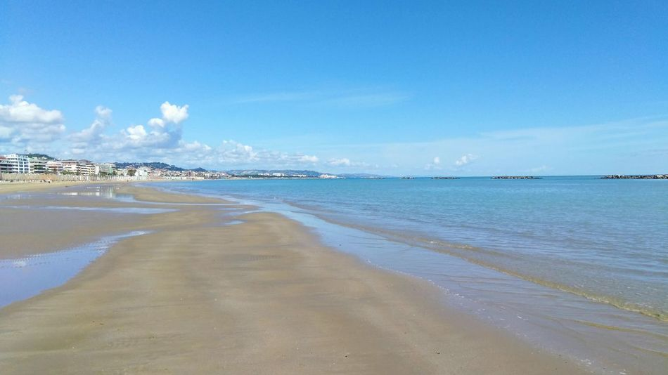 Sea view of the beach of Pescara, Abruzzo, Italy Water Wave Sea Swimming Low Tide Beach Blue Beauty Sand Horizon Sand Dune Coastal Feature Seascape Reef Bay Of Water Snorkeling Coast