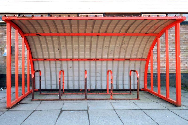 Empty metallic bicycle rack on footpath