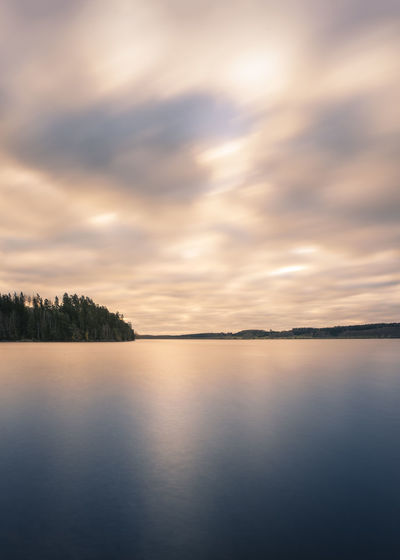 Windy morning at the lake in southern Finland. Beauty In Nature Blue Cloud - Sky Dramatic Sky Lake Lake View Landscape Light Long Exposure Morning Nature No People Outdoors Reflection Scenics Sky Smooth Water Sunset Water Windy Day
