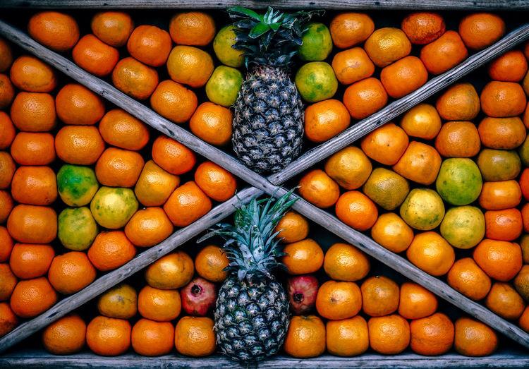Full frame shot of orange and pineapple fruits arranged