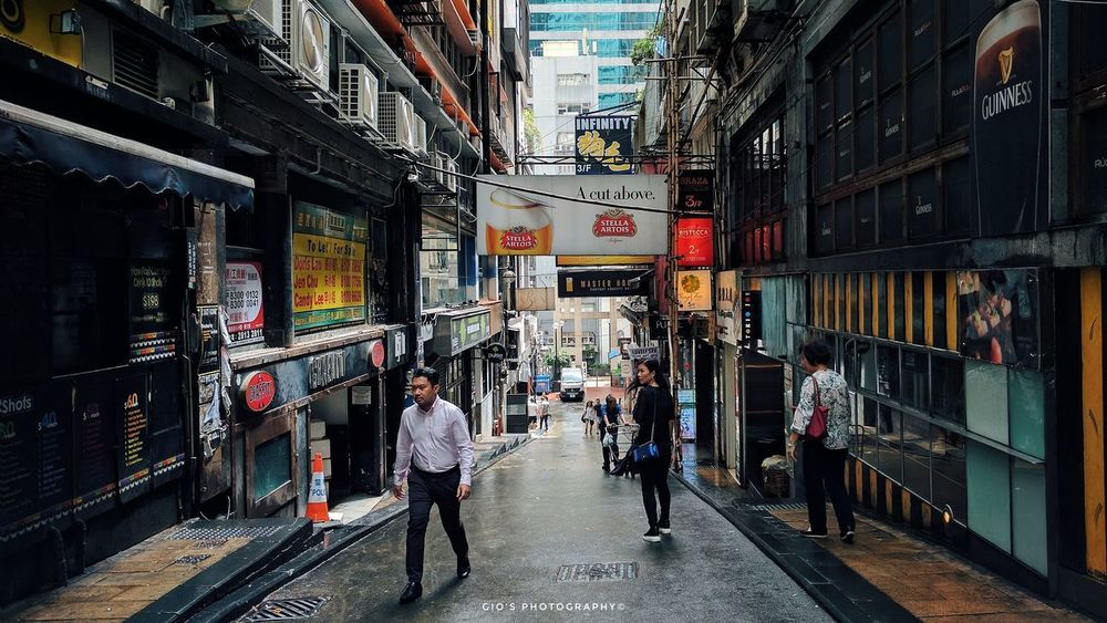 Lan Kwai Fong in the morning before the party animals tear it apart at night. Architecture Store Built Structure Real People Walking Around Nexus6P Nexus6pphotography Snapseed Edit Hong Kong Streetphotography City Street Streetphoto Hongkongstreet LanKwaiFong People Photography